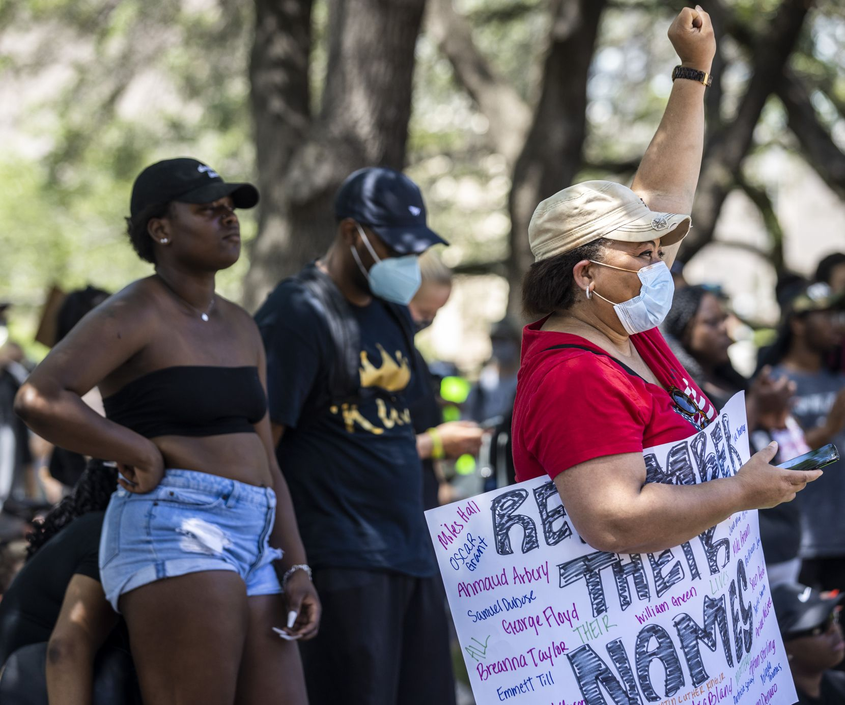 Valerie Fields Hill listens to speakers during a demonstration denouncing police brutality and systemic racism at Dallas City Hall on Friday.