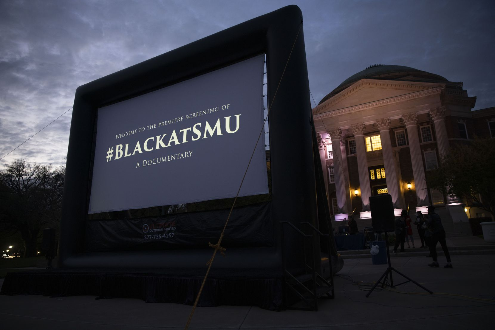 The screen before the premiere of #BlackAtSMU film, which documents five Black students' encounters with racism at SMU, at the Dallas Hall Lawn on SMU's Campus on Wednesday, April 21, 2021, in Dallas. (Juan Figueroa/The Dallas Morning News)