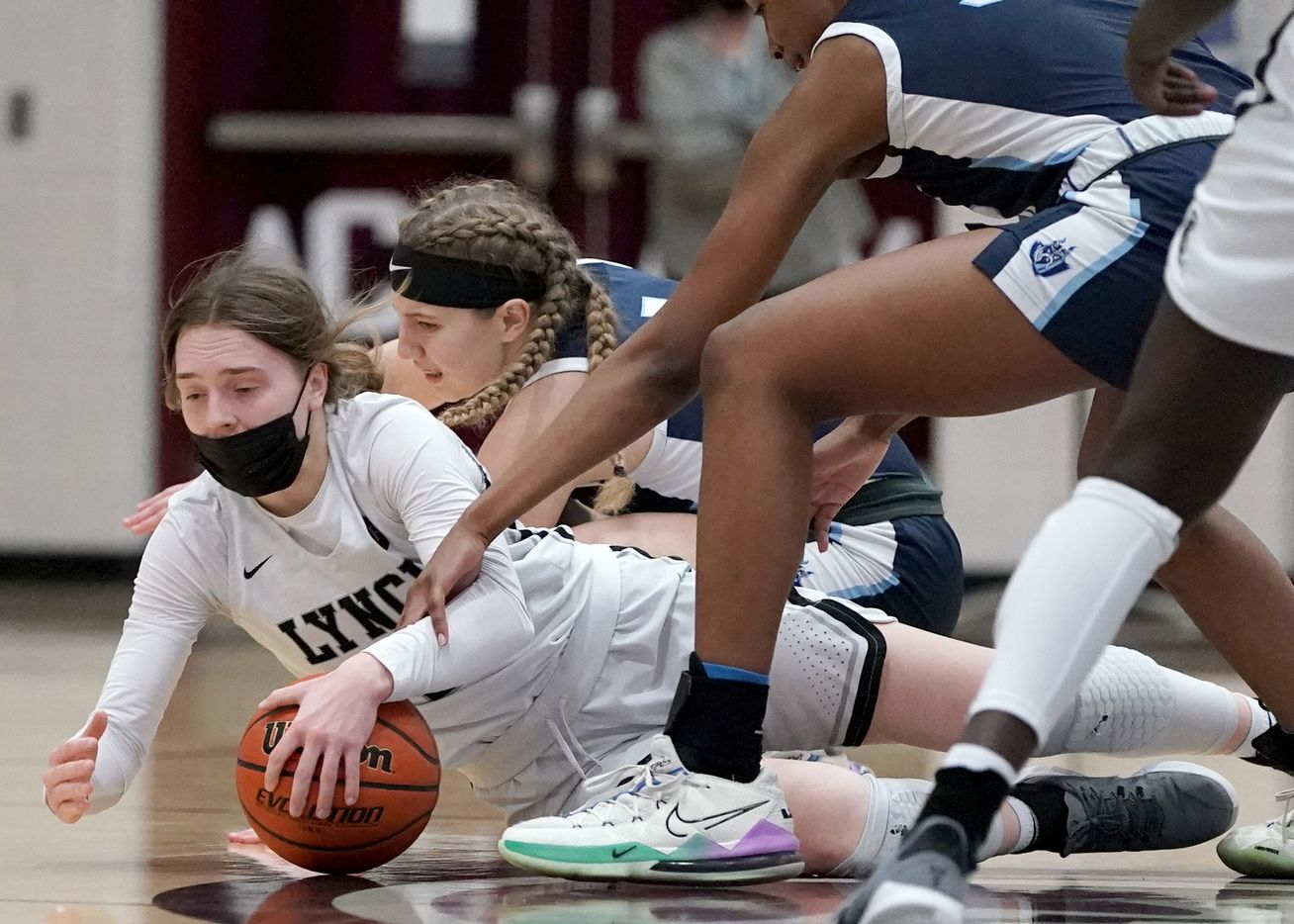 Dallas Bishop Lynch's Paige Bradley (15) fights for a loss ball against The Village School's Elizabeth Walton (1) and RyLee Grays (32) during the TAPPS 6A girls basketball championship game at A&M Consolidated High School in College Station, Texas on Friday, March 12, 2021. (Sam Craft/Special Contributor)