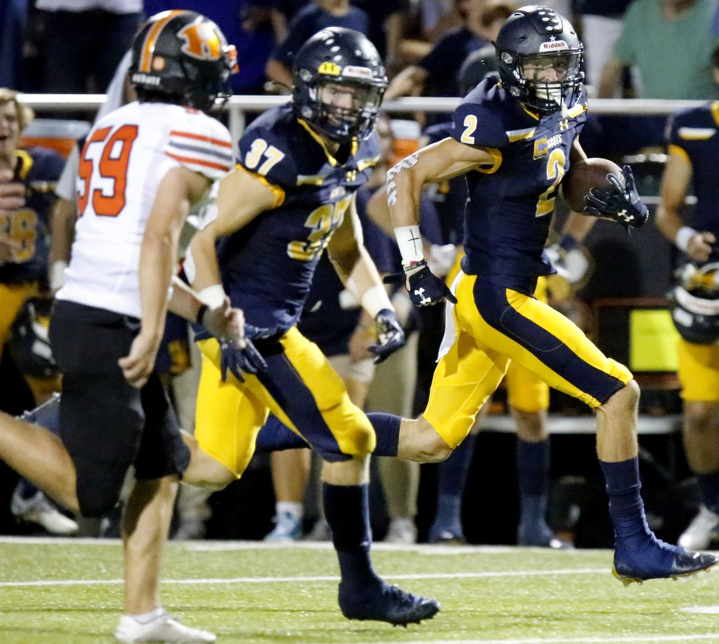 Highland Park High School wide receiver John Rutledge (2) returns a kickoff for a touchdown during the first half as Highland Park High School hosted Rockwall High School at Highlander Stadium in Dallas on, Friday, September 17, 2021. (Stewart F. House/Special Contributor)