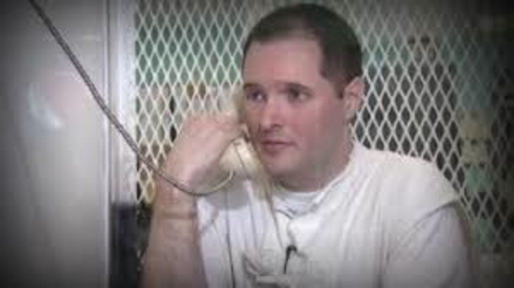 "Thomas ""Bart"" Whitaker talking on a telephone from prison in Polunsky, Texas. (Family handout/TNS)"