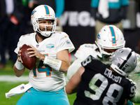 FILE — Miami Dolphins quarterback Ryan Fitzpatrick (14) looks to throw against the Las Vegas Raiders during the second half of an NFL football game, Saturday, Dec. 26, 2020, in Las Vegas.
