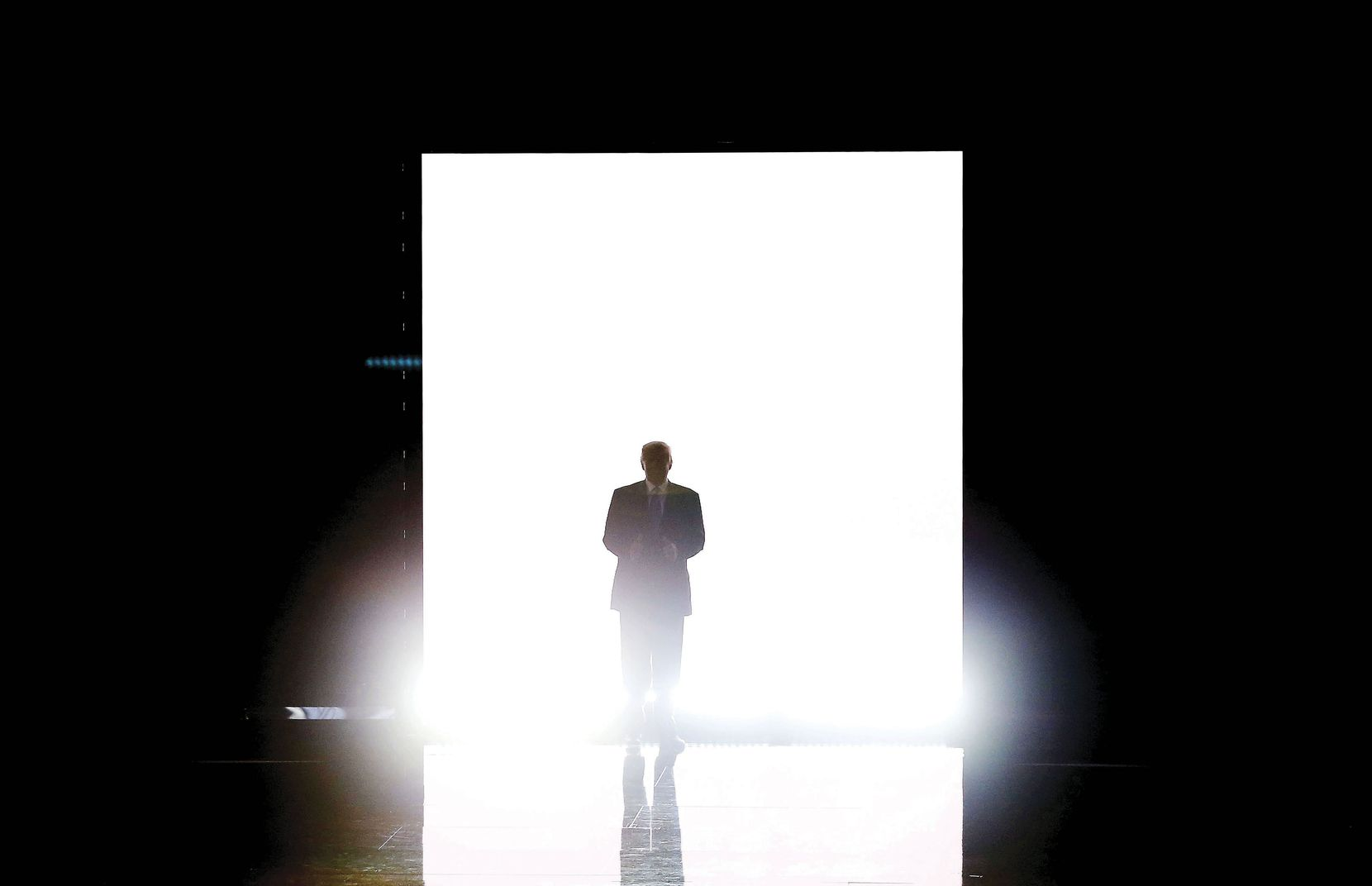Presumptive GOP nominee Donald Trump gave a thumbs-up signal as he made his way onto the stage before introducing his wife, Melania, to speak during the first day of the Republican National Convention at Quicken Loans Arena in Cleveland, Ohio on July 18.