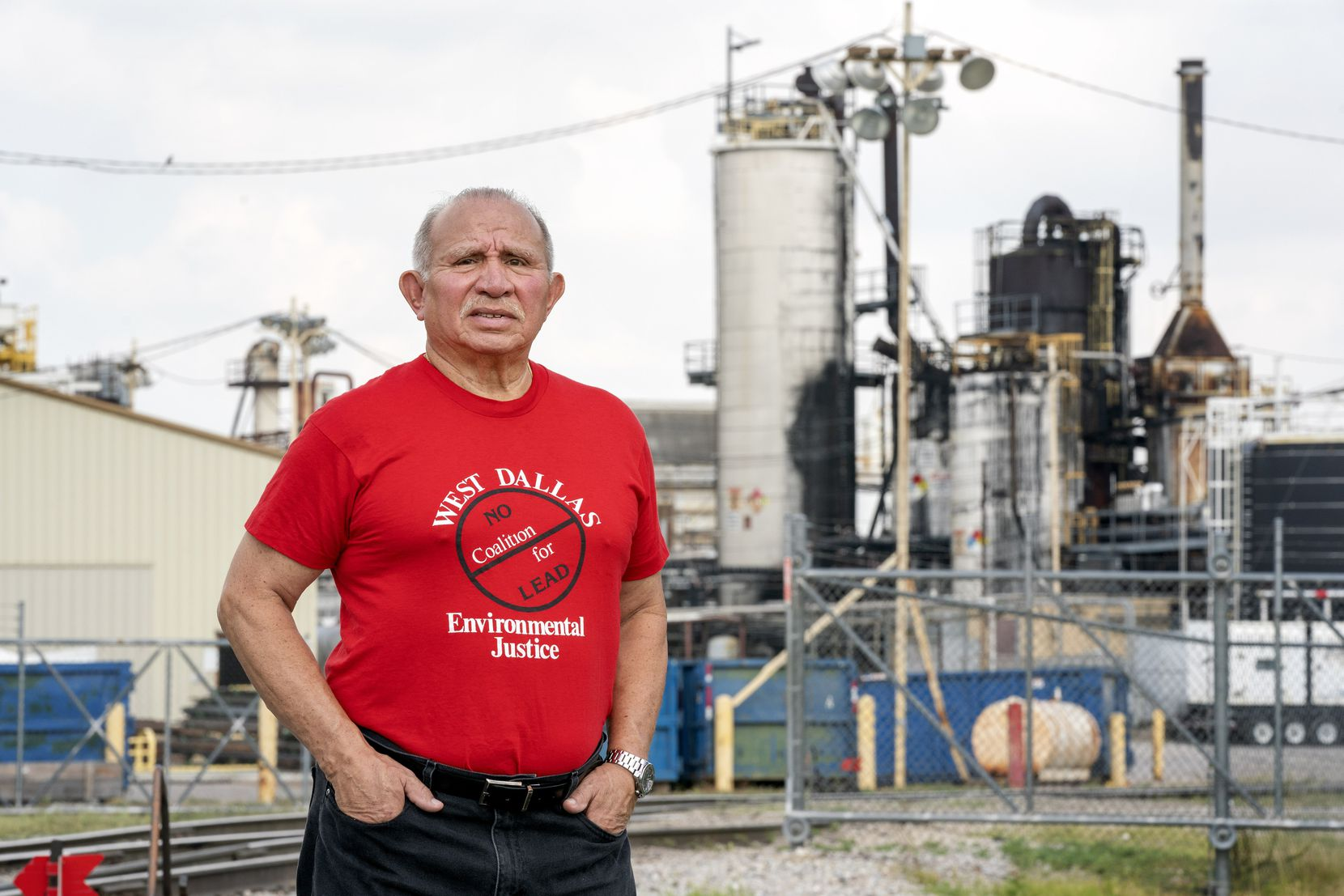 Luis Sepulveda, 69, founding president of the West Dallas Coalition for Environmental Justice, poses for a portrait in front of the GAF roofing materials plant, Monday, August 16, 2021 in West Dallas.  Sepulveda, who has long advocated for environmental justice in West Dallas has recently joined a locally organized effort concerned about potential pollutants, odors and noise from the GAF plant, where his father once worked.