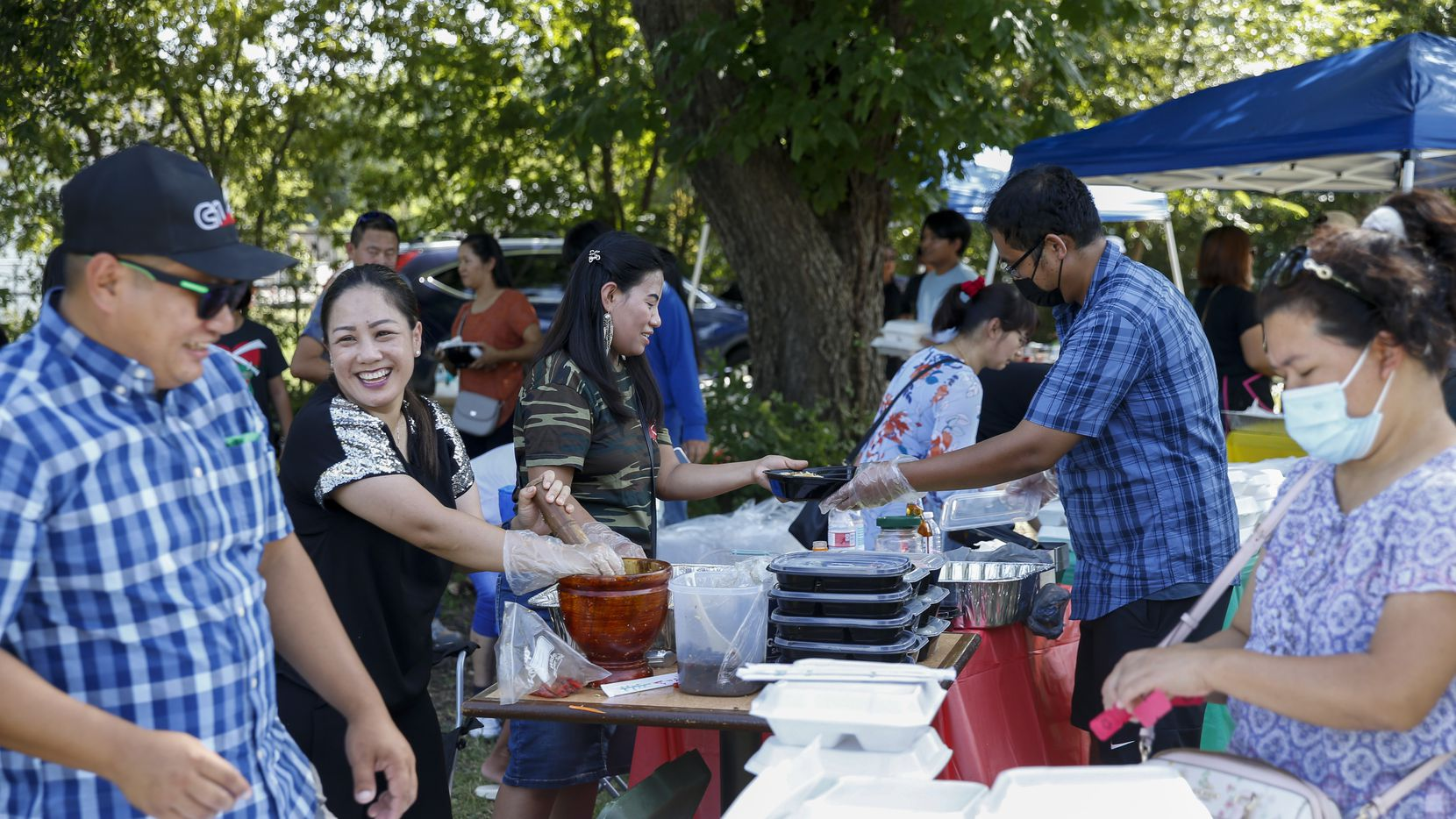 Residents prepare food for sale during a community fair and fundraiser for the Kachin state at DFW Kachin Baptist Church on Sunday, July 25, 2021, in Grand Prairie, Texas.
