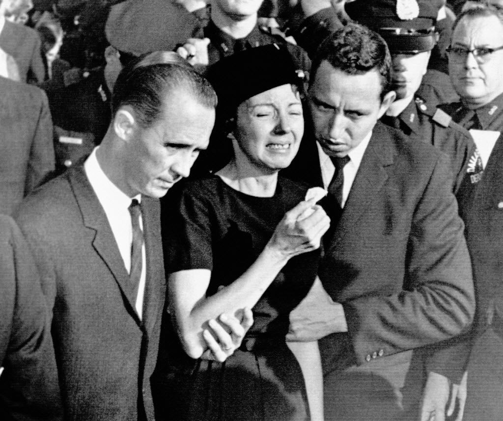 On Nov. 25, 1963, Marie Tippit, widow of police Officer J.D. Tippit, who was slain during the search for President John F. Kennedy's assassin, was led weeping from Beckley Hills Baptist Church in Dallas after funeral services for her husband.