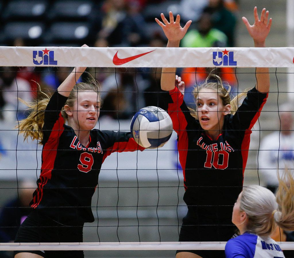 Lovejoy's Averi Carlson (9) and Grace Milliken (10) fail to block Friendswood's Makensy Manbeck (7) hit during the first set of a class 5A volleyball state semifinal match at the Curtis Culwell Center in Garland, on Friday, November 22, 2019.
