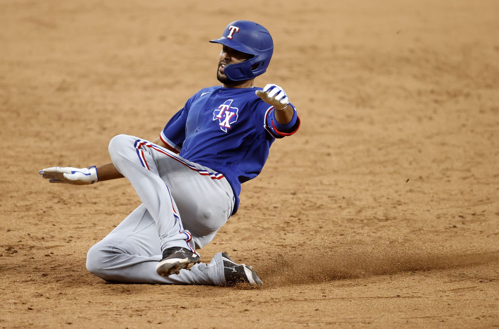 Texas Rangers Yadiel Rivera slides into third base for a triple during an intrasquad Summer Camp game inside Globe Life Field in Arlington, Texas, Friday, July 10, 2020. (Tom Fox/The Dallas Morning News)