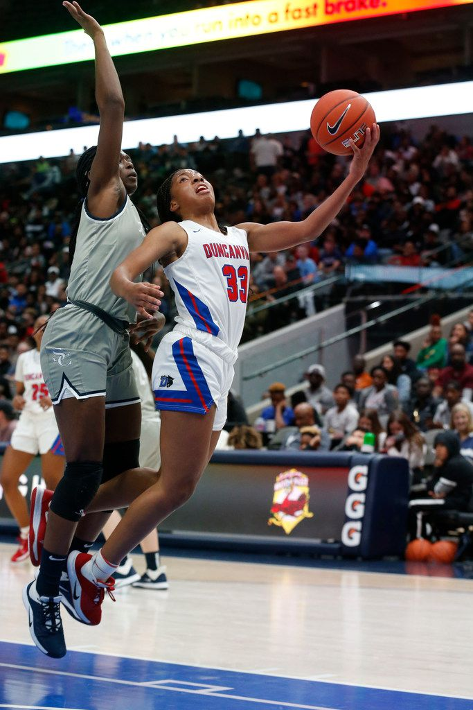 Duncanvilles's Nyah Wilson (33) is fouled by Sierra Canyon's Rosemary Odebunmi (4) during their girls high school basketball game during the Thanksgiving Hoopfest in Dallas, Tx, Saturday, Nov. 30, 2019. (Michael Ainsworth)