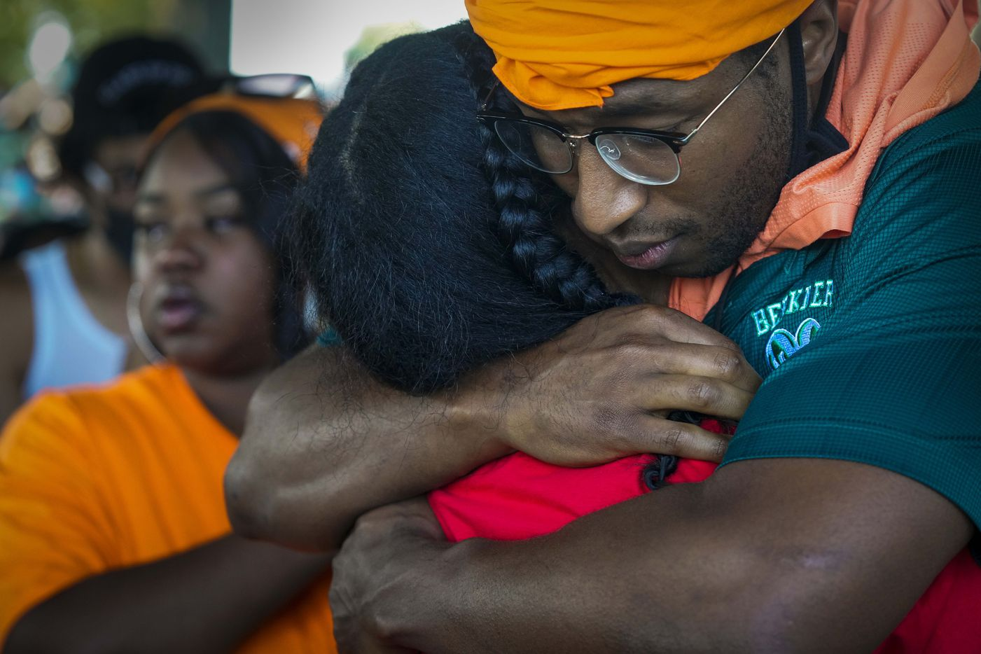 Teacher Andre Watson (right) hugs a speaker during a protest organized by Berkner High School students at Berner Park as protests continue after the death of George Floyd on Wednesday, June 3, 2020, in Richardson.