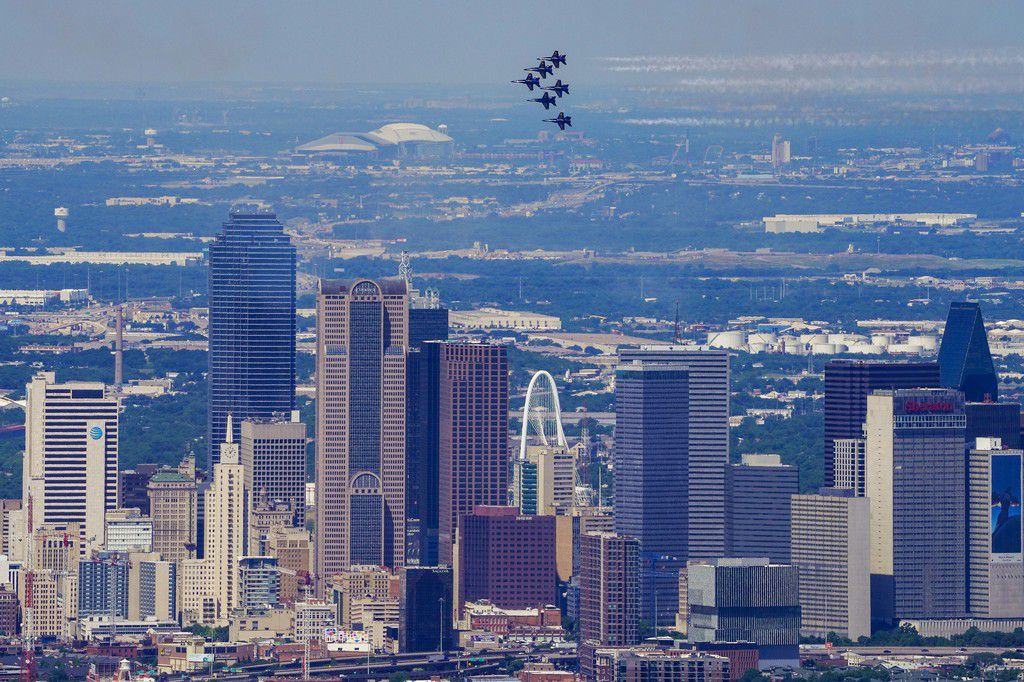 The U.S. Navy Blue Angels fly over the downtown Dallas skyline on Wednesday, May 6, 2020.  The appearance of the Navy flight demonstration squadron is part of nationwide series of flyovers called 'America Strong' to honor health care workers, first-responders and other essential frontline workers.