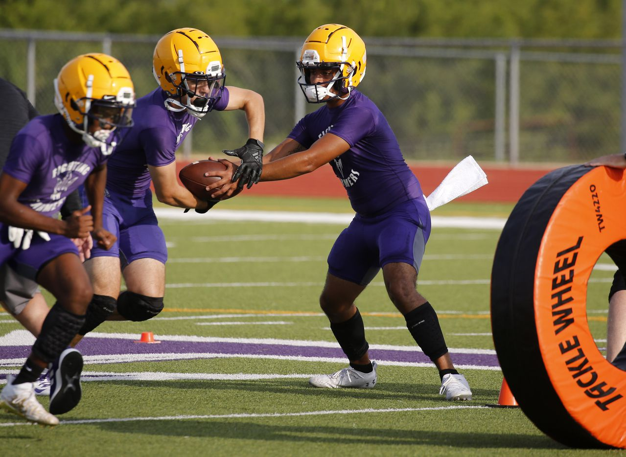 Farmersville's quarterback EJ Chairez fakes a handoff to Braden Lair during the first day of high school football practice for 4A's Farmersville High School in Farmersville, Texas on Monday, August 3, 2020. (Vernon Bryant/The Dallas Morning News)