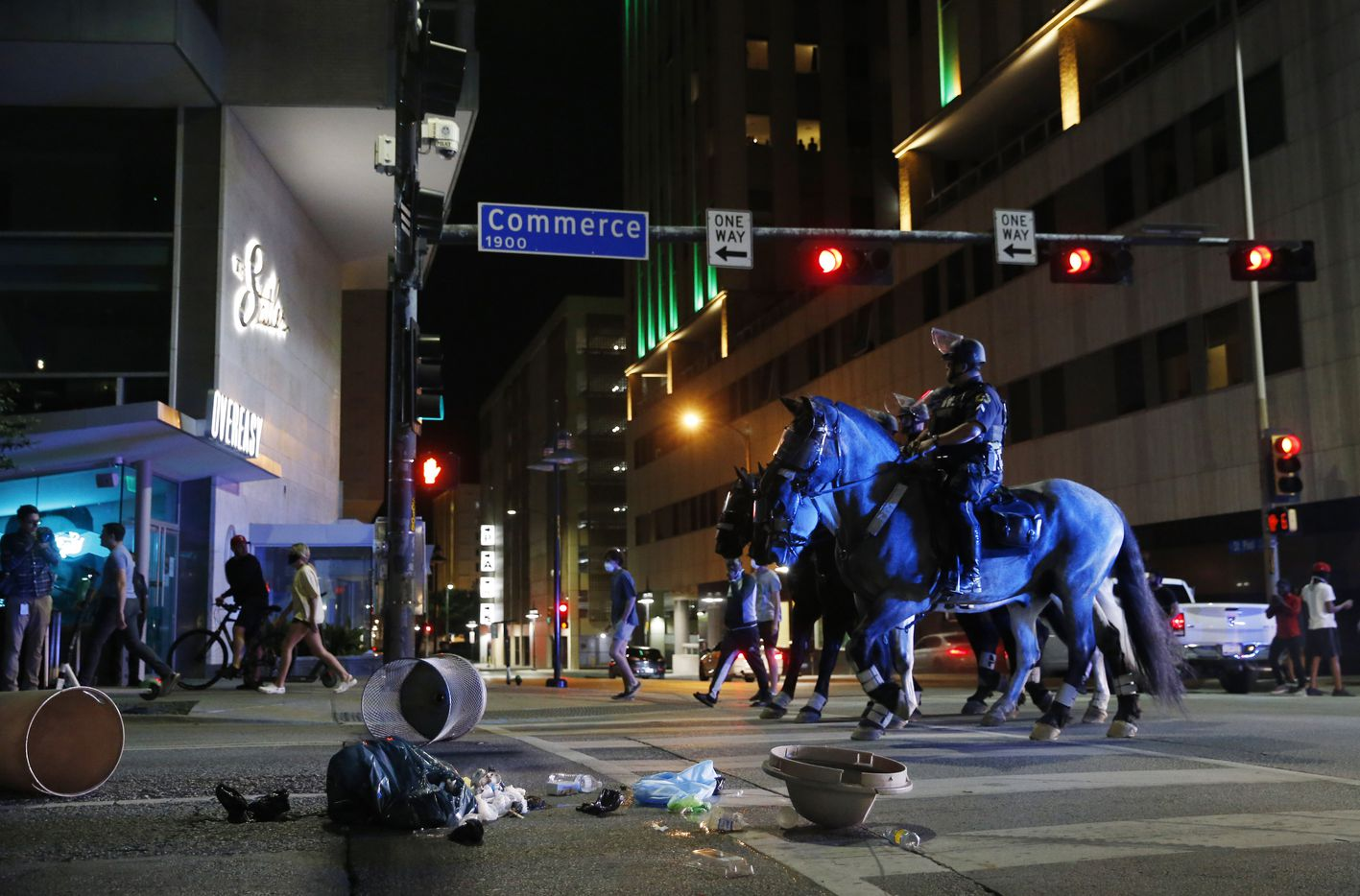 Dallas police make their way along Commerce amongst debris put in the street by protestors during a march against police brutality in downtown Dallas, on Friday, May 29, 2020. George Floyd died in police custody in Minneapolis on May 25.