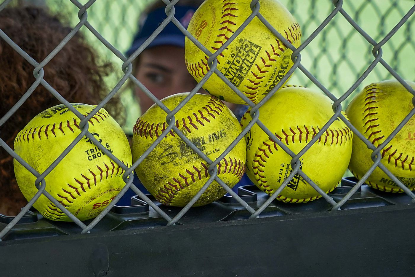 Game balls are lined up in a dugout during a game between the Texas Glory 18U and the American Freedom Gold Coleman 18U in the Triple Crown Texas State Tournament at Spirit Park on Monday, June 15, 2020, in Allen, Texas. (Smiley N. Pool/The Dallas Morning News)