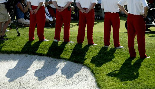 Tournament volunteers clad in the signature red slacks identifying them as Salesmanship Club members stand at attention during the 2006 Byron Nelson Classic trophy presentation.