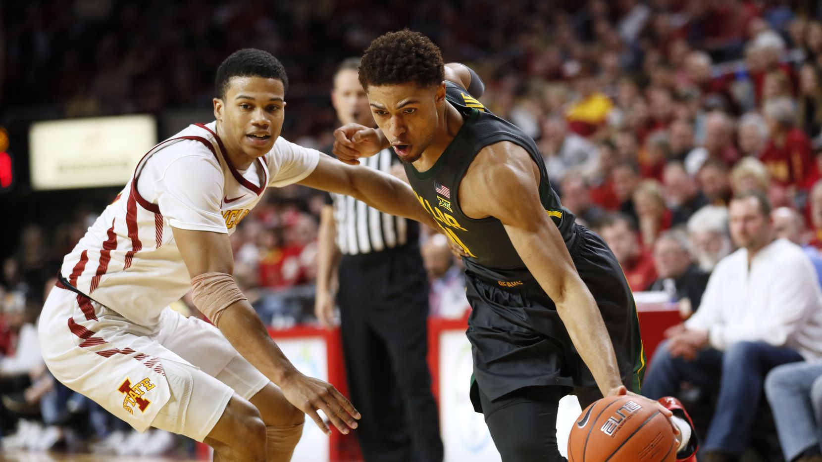 Baylor guard MaCio Teague drives past Iowa State guard Rasir Bolton, left, during the second half of an NCAA college basketball game Wednesday, Jan. 29, 2020, in Ames, Iowa. Baylor won 67-53.