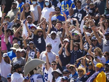 Dallas Cowboys fans cheer at the direction of team mascot Rowdy during a joint practice with the Los Angeles Rams at training camp on Saturday, Aug. 7, 2021, in Oxnard, Calif.