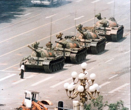 A Chinese man stands in front of a line of tanks in Beijing stopping their advance down Beijing's Cangan Blvd, near Tiananmen Square, on June 5, 1989.