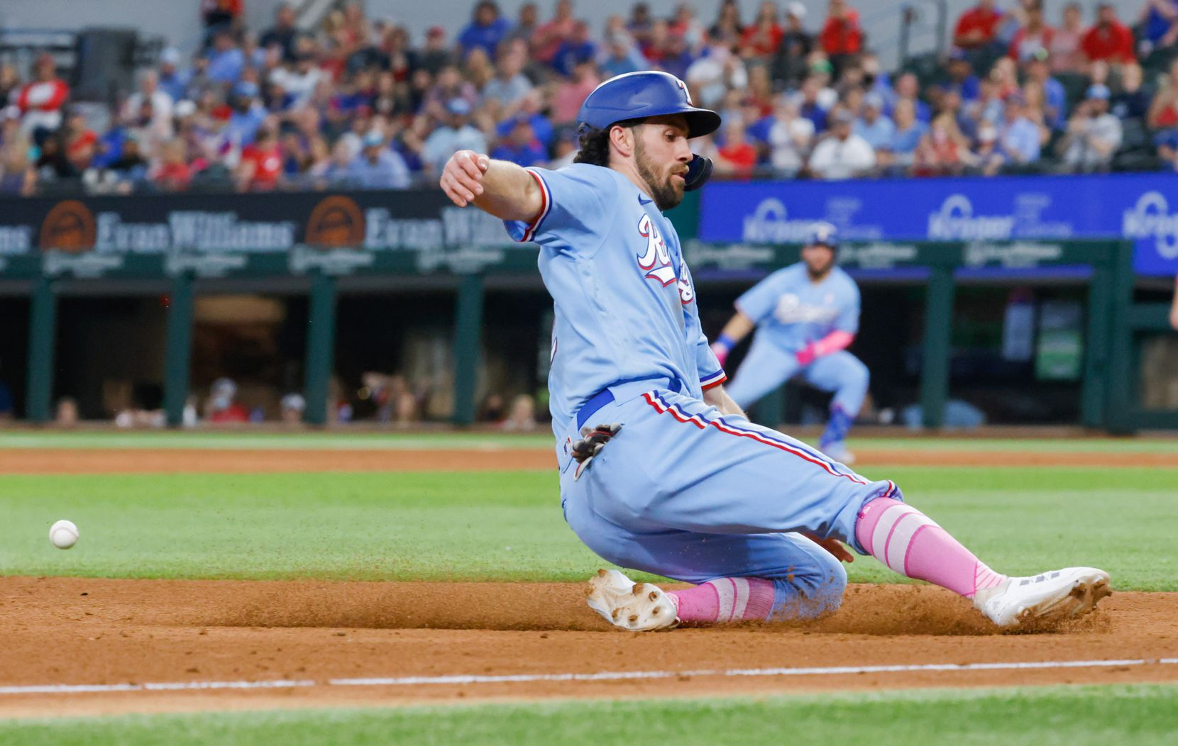 Texas Rangers shortstop Charlie Culberson (2) slides to third off Texas Rangers catcher Jose Trevino (23) single against the Seattle Mariners during the bottom of the sixth at Globe Life Field on Sunday, May 9, 2021, in Arlington. The Rangers won, 10-2. (Juan Figueroa/The Dallas Morning News)