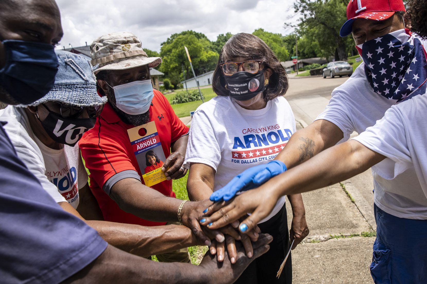 City Council member Carolyn King Arnold (center) and her supporting team huddled before they re-canvassed voter homes in the Glen Oaks neighborhood in South Dallas on Friday, May 21, 2021. Arnold is in a runoff against Dallas ISD trustee Maxie Johnson.