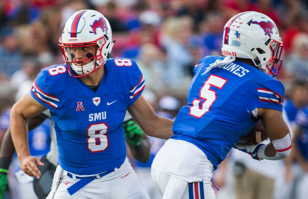 Southern Methodist Mustangs quarterback Ben Hicks (8) hands off the ball to Southern Methodist Mustangs running back Xavier Jones (5) during the first quarter of a football game between UNT and SMU on Saturday, September 9, 2017 at SMU's Ford Stadium in Dallas. (Ashley Landis/The Dallas Morning News)