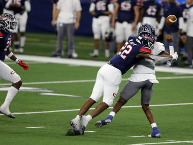 Denton Ryan defender MarQuice Hill Jr. (22) forces a fumble from Mansfield Summit Qb David Hopkins (7). Ryan's DJ Arkansas (21) recovered an advanced it for a touchdown during the second half of the Class 5A Division I state semifinal football playoff game at AT&T Stadium in Arlington on Friday, January 8, 2021. Ryan won 49-35.