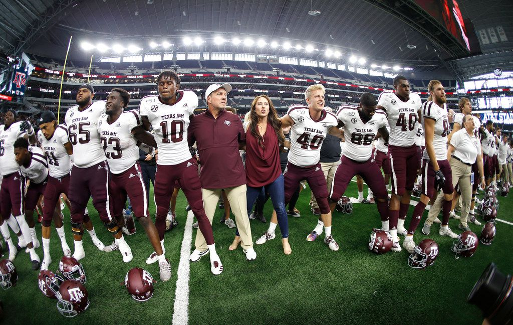 Texas A&M head coach Jimbo Fisher celebrates with his team after defeating Arkansas in an NCAA college football game Saturday, Sept. 28, 2019, in Arlington, Texas. Texas A&M won 31-27. (AP Photo/Ron Jenkins)