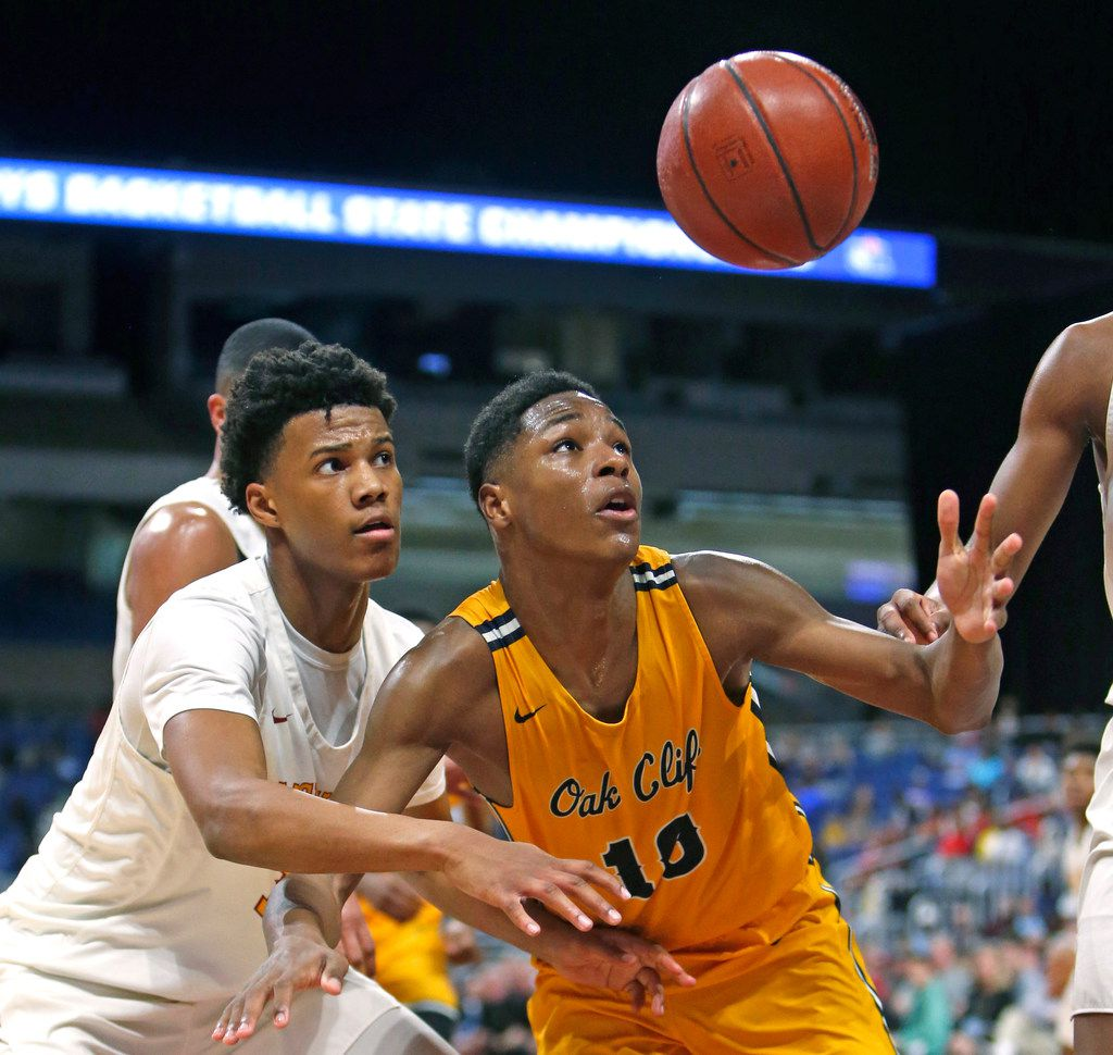 Oak Cliff Faith Family's Trae Clayton #10 reaches for a loose ball in front of Houston Yates's Rubin Jones #15. UIL boys basketball 4A State semi-final between Houston Yates and Oak Cliff Faith Family on Friday, March 8, 2019 at the Alamodome in San Antonio, Texas. (Ron Cortes/ Special Contributor) ORG XMIT: 10044095A
