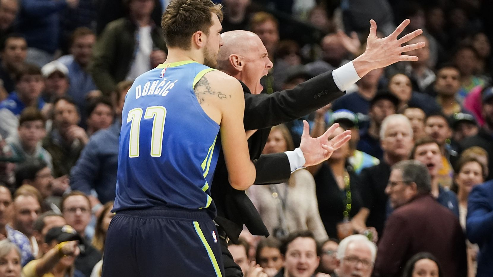 Dallas Mavericks head coach Rick Carlisle is restrained by guard Luka Doncic after being ejected after picking up a technical foul during the second half of an NBA basketball game against the Los Angeles Lakers at American Airlines Center on Friday, Jan. 10, 2020, in Dallas.