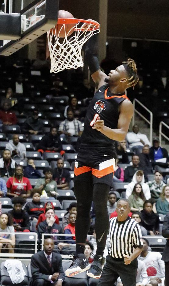 Lancaster High School guard Mike Miles (1) dunks the basketball during the first half as Kimball High School played Lancaster High School for the Class 5A Region II championship at the Curtis Colwell Center in Garland on Saturday, March 7, 2020.