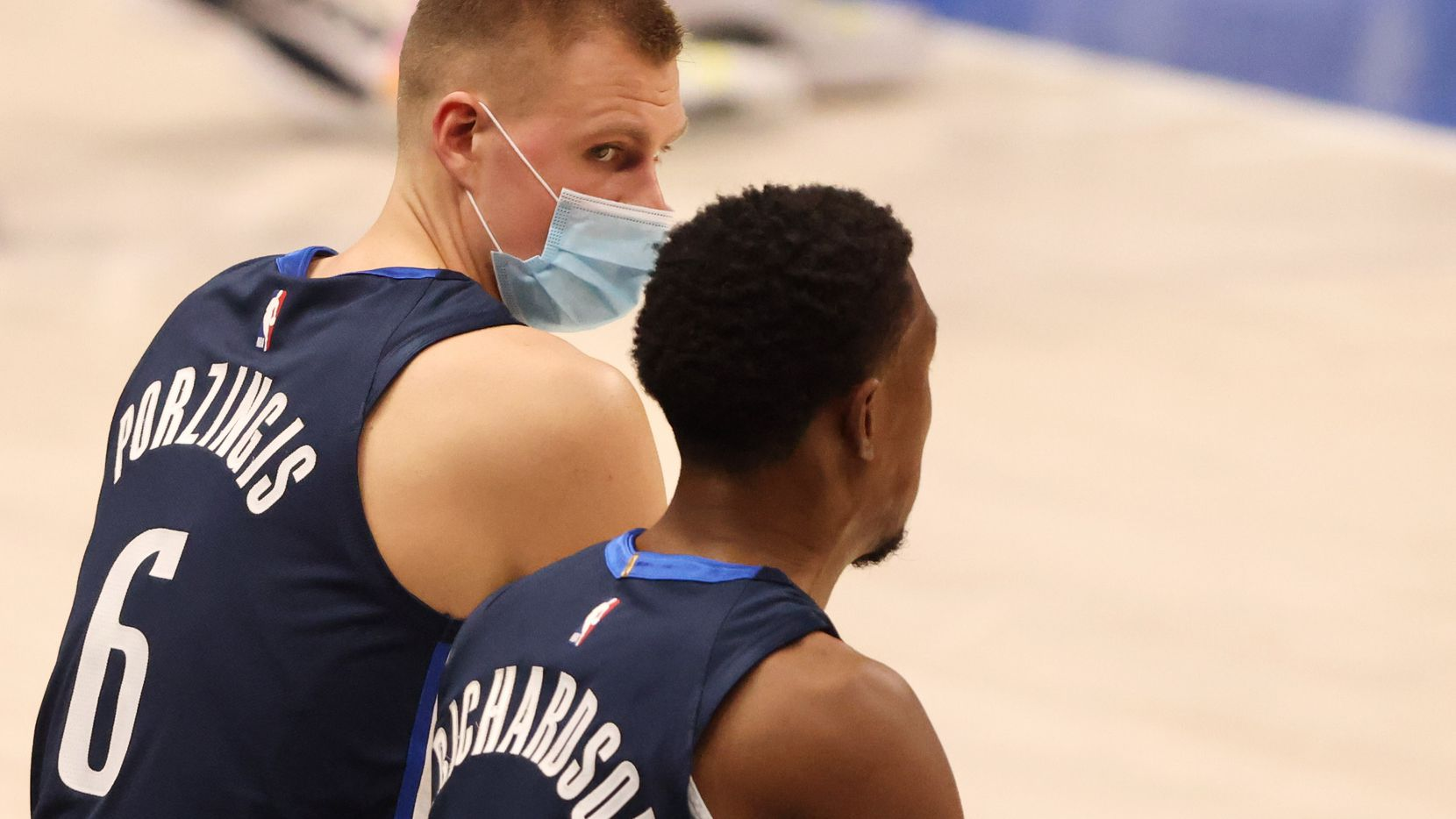 Dallas Mavericks forward Kristaps Porzingis (6) talks with Dallas Mavericks guard Josh Richardson (0) in a game against the Phoenix Suns during the second quarter of play at American Airlines Center on Monday, February 1, 2021in Dallas.