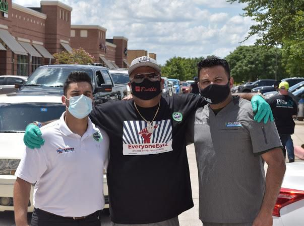 Ram Mehta (center), owner of In-Fretta pizza restaurants in Plano and Irving and founder of the #EveryoneEatz movement, is shown during an event with Ahad Rajwani of Red Carpet Roofing and Asad Ahsan of Vital Dental, both of whom are also volunteers with EveryoneEatz.