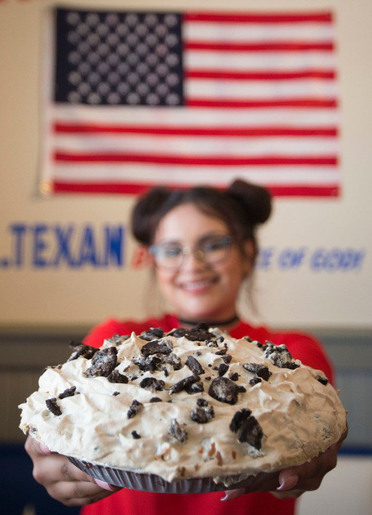 Waitress Ataly Rozo shows off a Mile-High Oreo Cream Pie at the new Norma's.