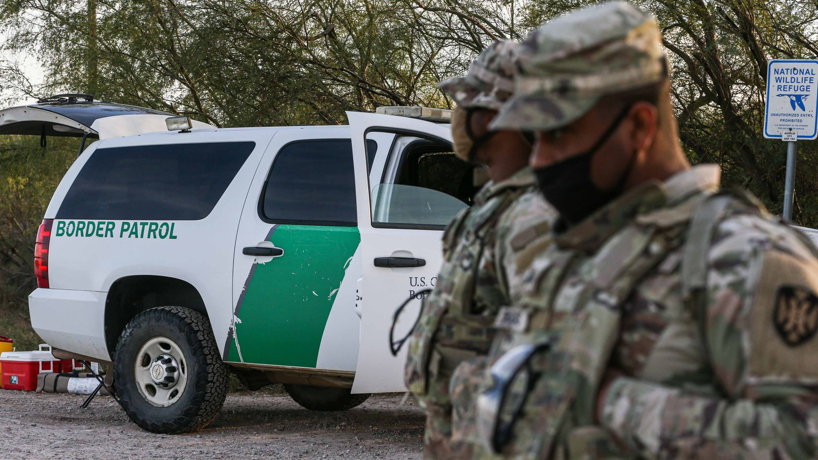 Army guardsmen that provide support to the border patrol, stand vigilant near the Texas border with Mexico in Hidalgo on January 13, 2021.