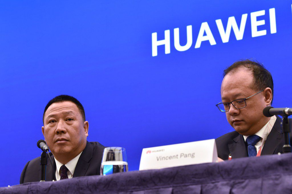 Song Liuping (left), chief legal officer of Chinese tech giant Huawei, and Vincent Pang, head of corporate communications, attend a press conference in Shenzhen May 29, 2019.