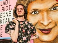 David Schwartz poses in front of the Sylvia Rivera + Marsha P Johnson Mural in Dallas on Friday, July 23, 2021. Schwartz is a former resident of Dallas Hope Center, a transitional living center for LGBTQ youth ages 18-24 experiencing homelessness.