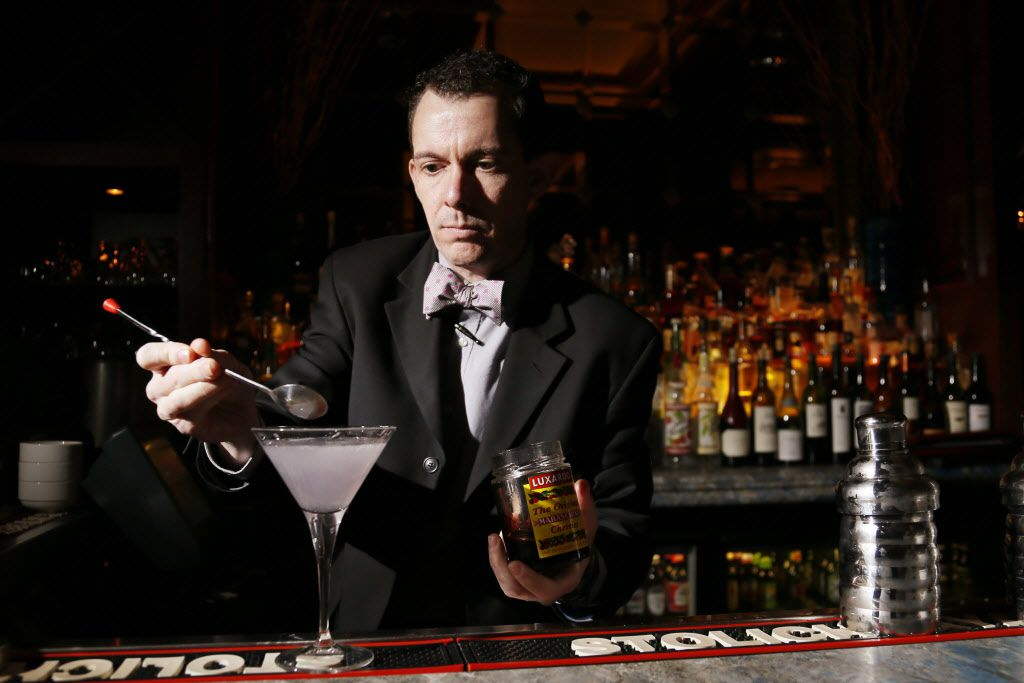 New bar manager, Chad McClendon makes a cocktail at the Library Bar at the Warwick Melrose Hotel in Dallas on February 3, 2015.
