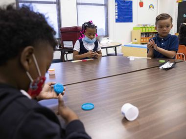 Mya Smith (center) and Ziggy Matherly (right) play with play-doh during the first day of school on Monday, Aug. 2, 2021, at H.I. Holland Elementary School in Dallas. Arlington ISD will start school Monday, Aug. 16.