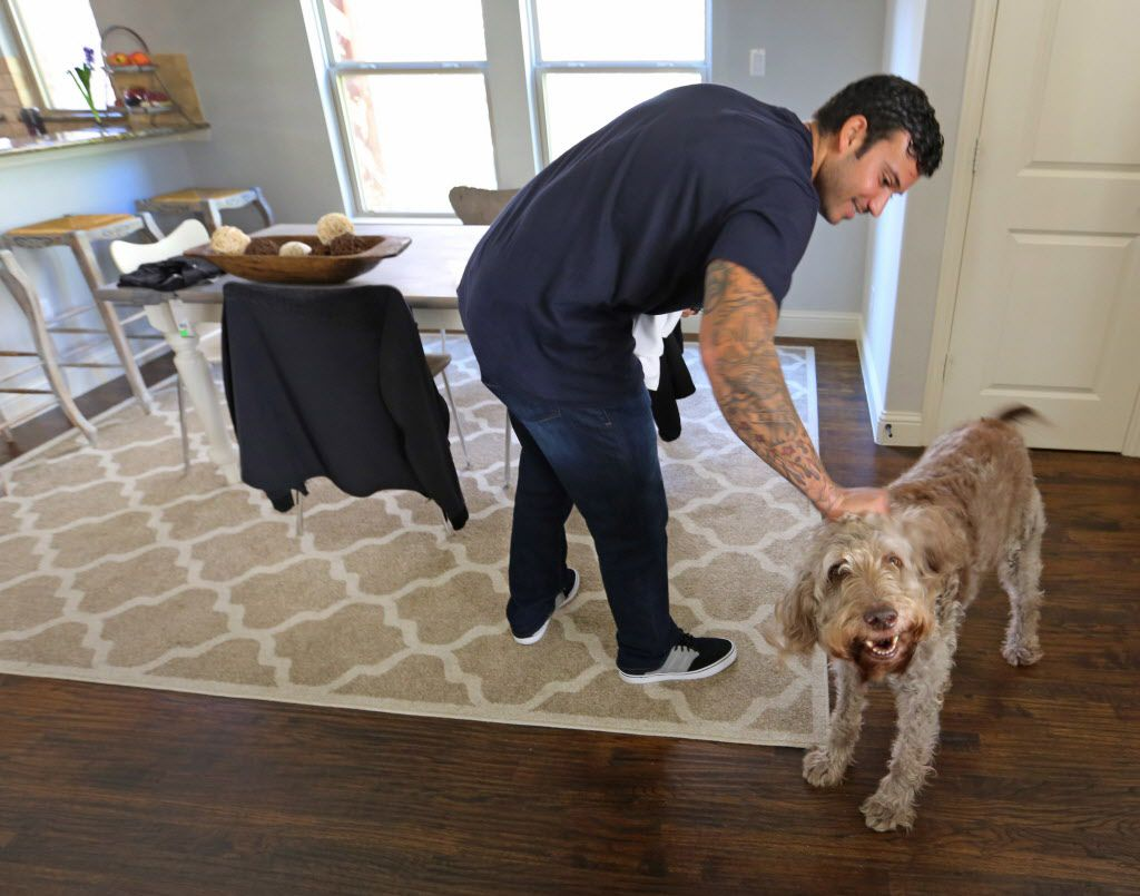 Texas Rangers relief pitcher Matt Bush is greeted by his dog Kahlœa as he returns home from a workout at Globe Life Park in Arlington, photographed on Thursday, January 26, 2017. (Louis DeLuca/The Dallas Morning News)