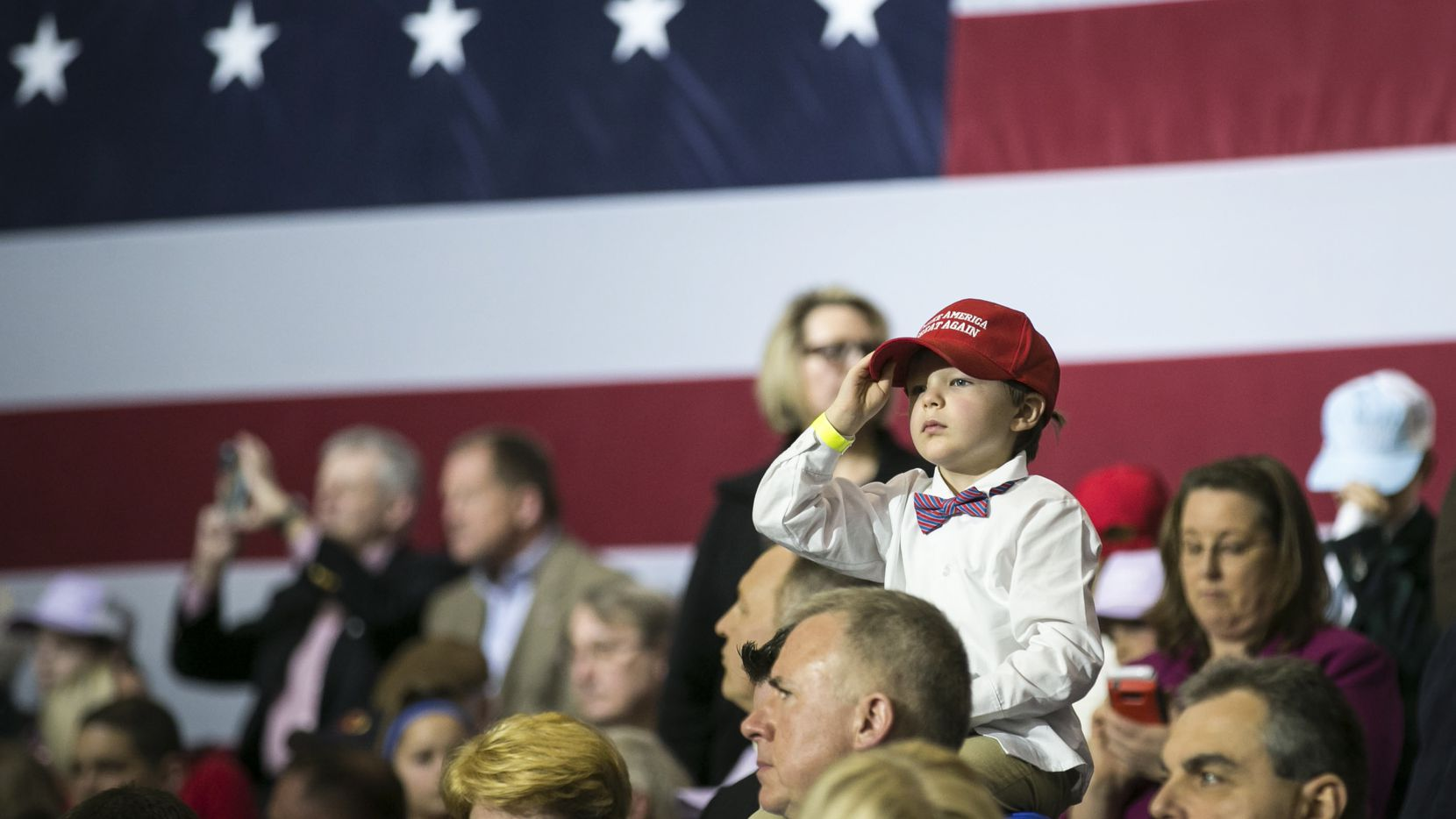 "A child wearing a Make America Great Again hat in a crowd waiting to hear President Donald Trump speak at a campaign-style rally at the Kentucky Exposition Center in Louisville, March 20, 2017. Trump delivered a rollicking populist and nationalist appeal on Monday, promising to renegotiate trade agreements, clamp down on illegal immigration, keep terrorists out of the country – all in the service of putting ""America First."" (Al Drago/The New York Times)"