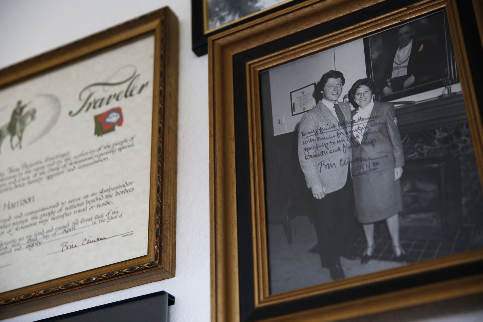 Adlene Harrison poses with President Bill Clinton in a photo from December 1986 that  hangs on the wall of Harrison's home in Dallas.
