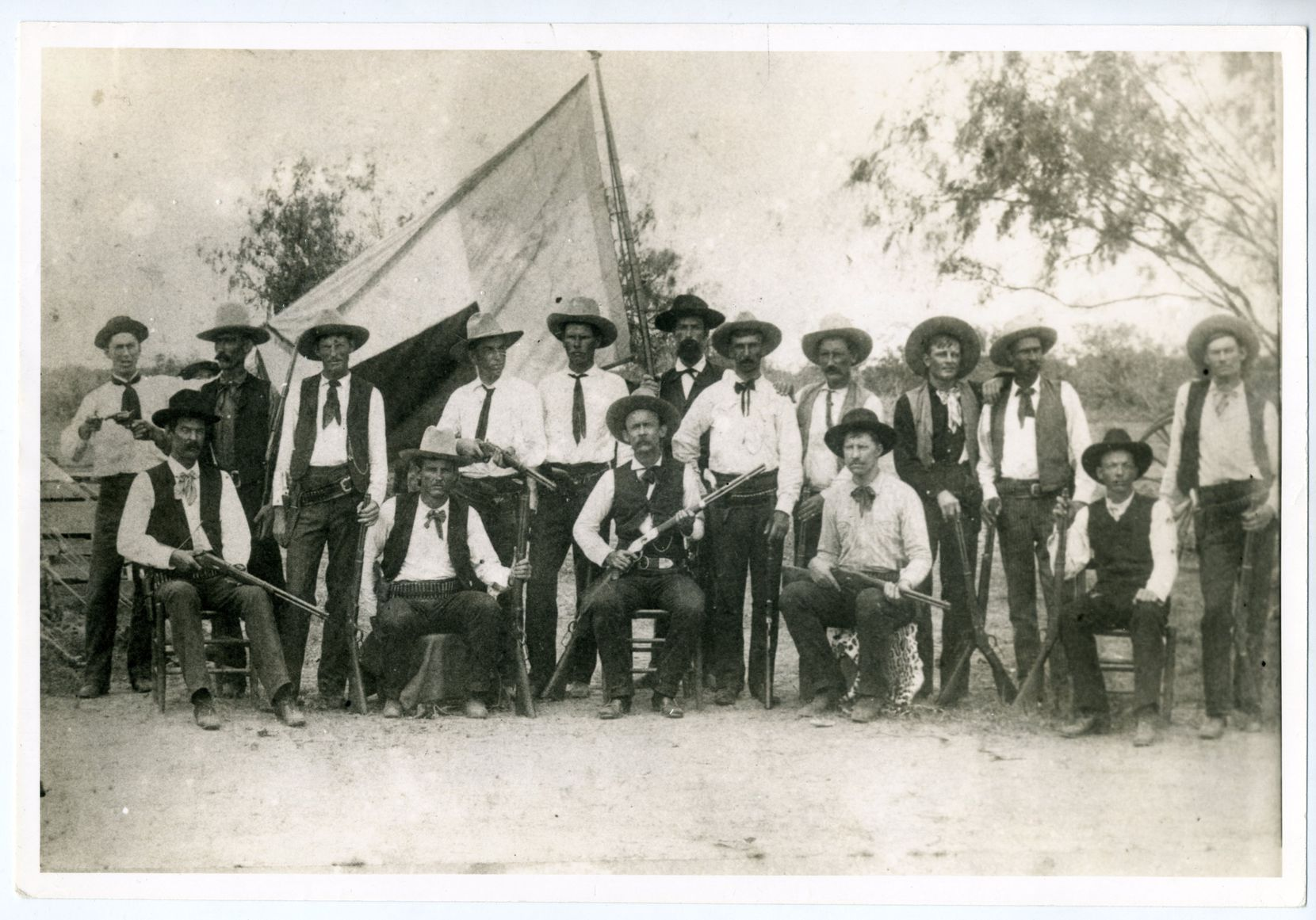 "A typical Ranger company toward the end of the 19th century — heavily armed and backed by the Texas flag. This is a photograph from Doug J. Swanson's new book, ""Cult of Glory: The Bold and Brutal History of the Texas Rangers."""