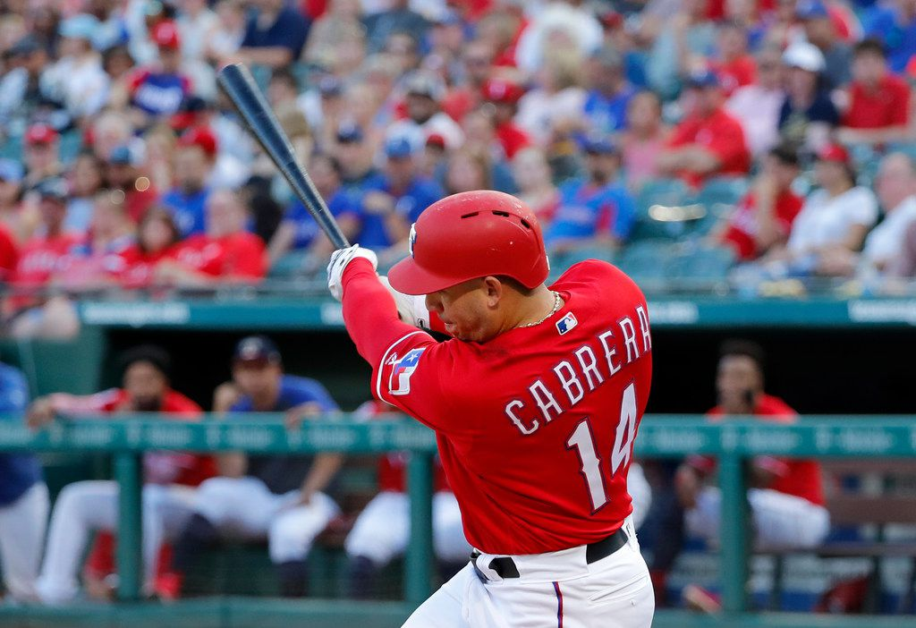 Texas Rangers' Asdrubal Cabrera follows through on a sacrifice fly to right off Los Angeles Angels' Griffin Canning during the second inning of a baseball game in Arlington, Texas, Thursday, July 4, 2019. The shot scored Joey Gallo. (AP Photo/Tony Gutierrez)