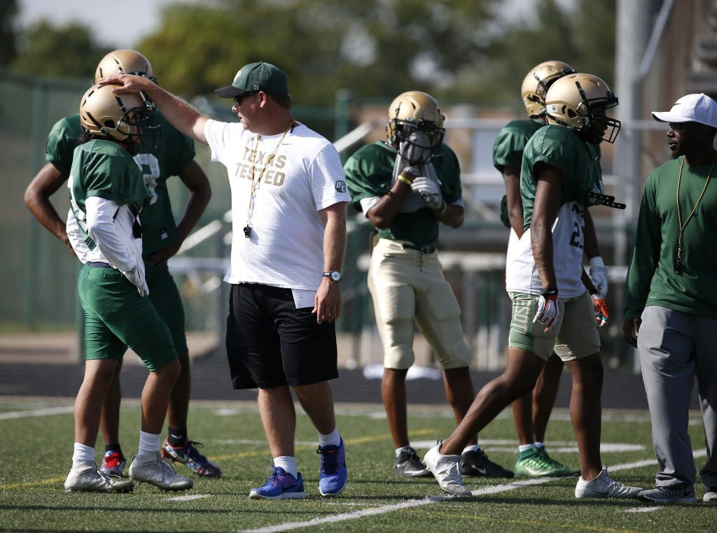 DeSoto head football coach Todd Peterman coaches players during spring practice at Eagle Stadium in DeSoto, Texas on Tuesday, April 25, 2017. (Rose Baca/The Dallas Morning News)