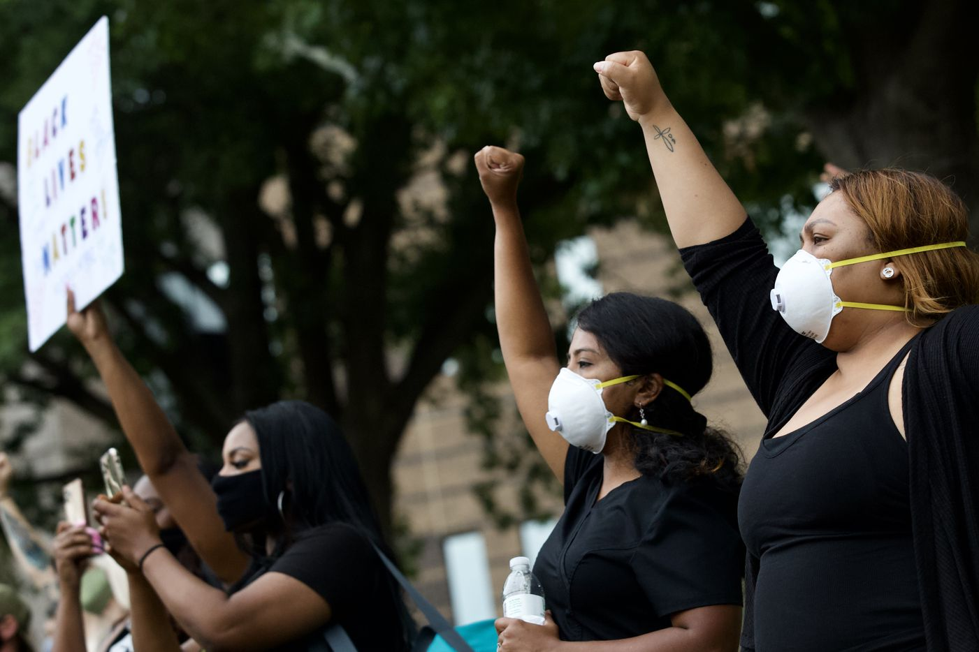 Lanie Alexander (far right) and Lalitha Natarajan (2nd from right) join protesters gather outside the Frank Crowley Courts building past the city's 7 p.m. curfew during a demonstration denouncing police brutality on Monday, June 1, 2020.