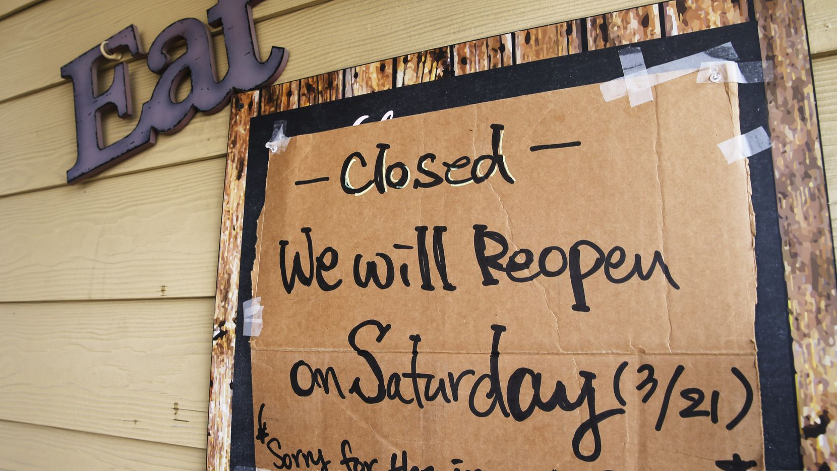 A closed sign next to the door at 5th Street Patio Cafe in Frisco, Texas, on Thursday, March 19, 2020. Texas Gov. Greg Abbott announced Thursday the temporary closing of schools, restaurants, gyms and bars statewide at a news conference.