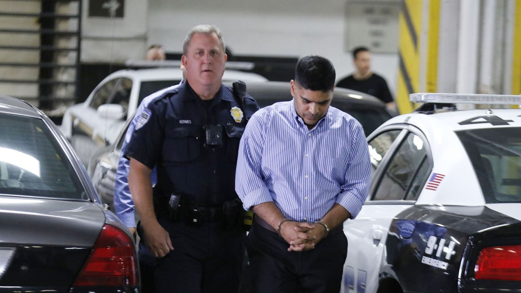 Wesley Mathews, right, adoptive father of Sherin Mathews, was arrested and charged with Injury to a Child arrives at the Lew Sterrett Justice Center on Wednesday, October 25, 2017 in Dallas. He was transferred from the Richardson, Texas jail and his bail has been set at $1 million. He was arrested on Oct. 23, 2017 after offering a new account of how his daughter went missing two weeks earlier.