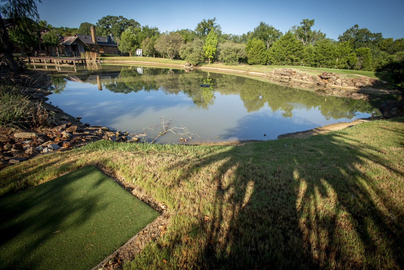 Golf tee, water hazard and green at 5101 Kensington Ct., in Flower Mound, Texas on August 19, 2020. (Robert W. Hart/Special Contributor)