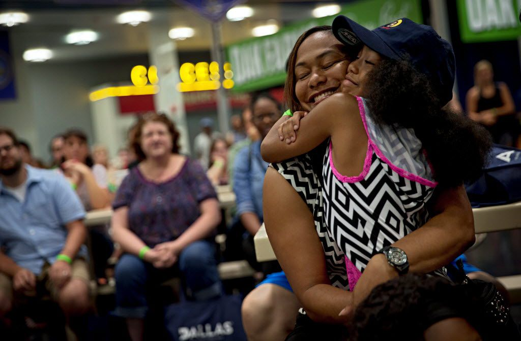 """Camryn Sternes (right) hugs her mother, Tiffany Sternes, during the 2016 Big Tex Choice Awards Sunday, August 28, 2016 at Fair Park in Dallas. The annual event, held ahead of the State Fair of Texas, recognizes the best fried foods entered into consideration for sale at the fair. The elder Sternes' mother, Ruth Hauntz and her team won """"Best Taste"""" for their Fried Jell-O. (G.J. McCarthy/The Dallas Morning News)"""