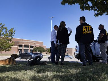 ATF officials gather in front of Mansfield Timberview High School in Arlington, Texas following a shooting there, Wednesday, October 6, 2021. Four people were injured in the shooting and the suspect turned himself into the Arlington police. (Tom Fox/The Dallas Morning News)